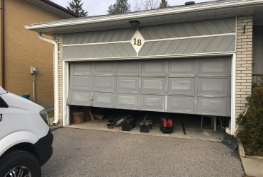 Garage Door out of Track Milton